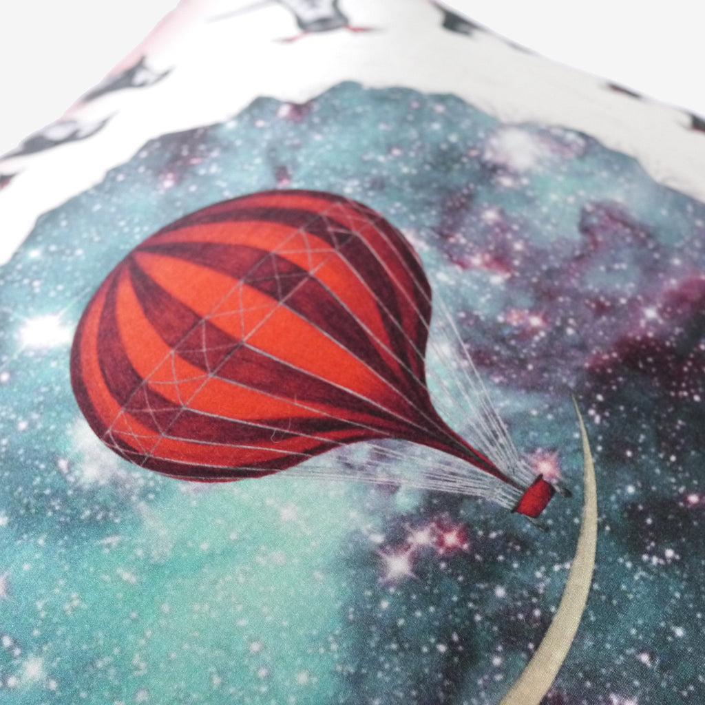 The magical hot air ballon featured on the Expedition silk and cotton Printed cushion by luxury designer and illustrator Emma J Shipley