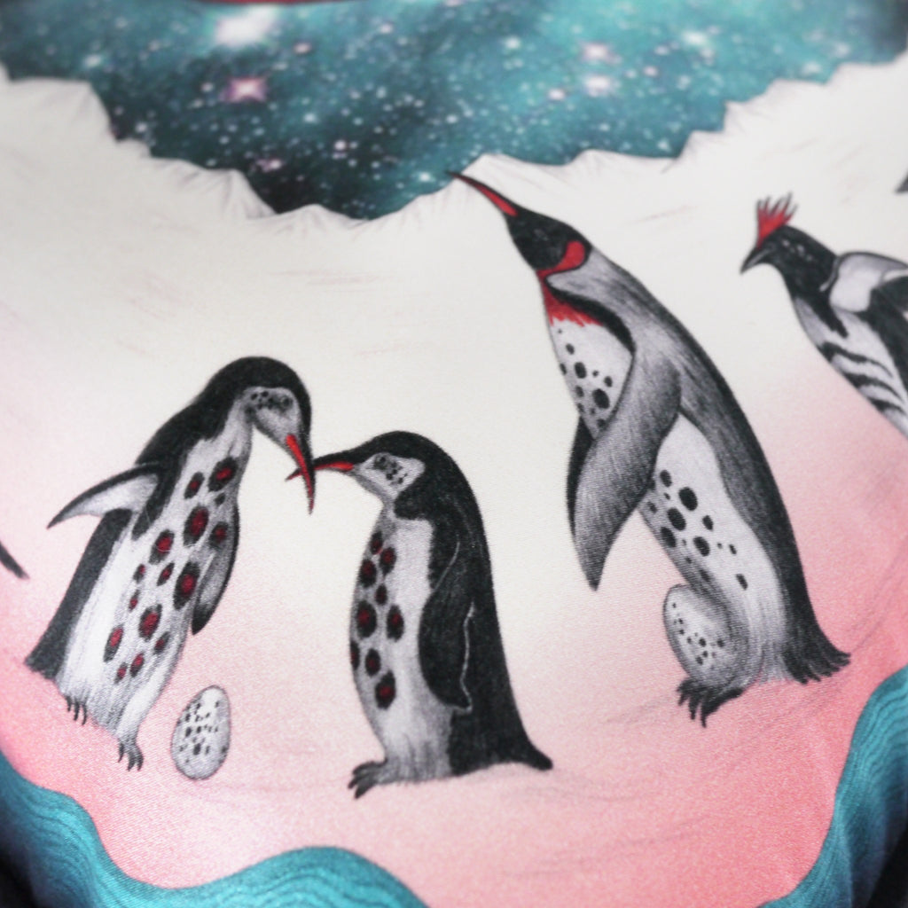 The hand-drawn penguins featured on the luxury Expedition silk and cotton cushion by Emma J Shipley - a perfect Christmas Gift
