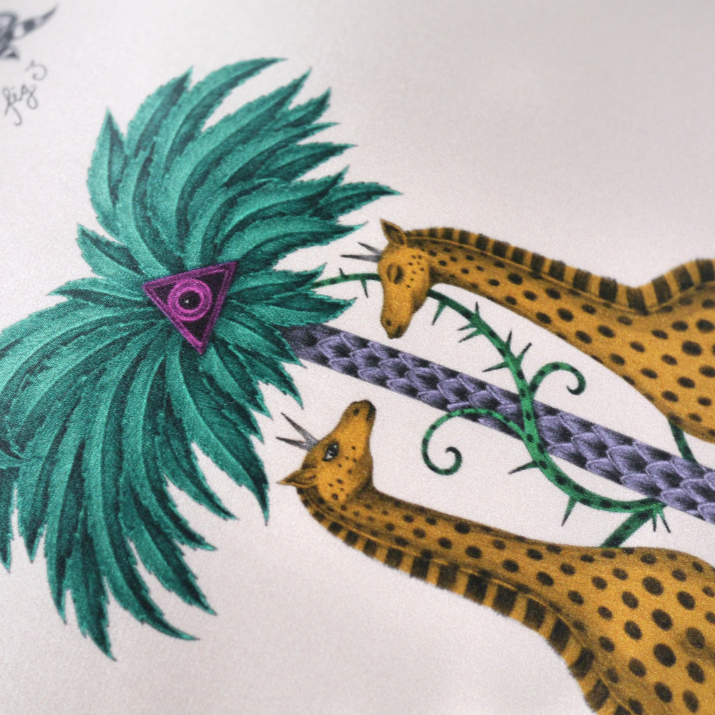 A detailed close-up photo of the hand-drawn giraffes that feature on the luxury Giraffe Cushion by Emma J Shipley