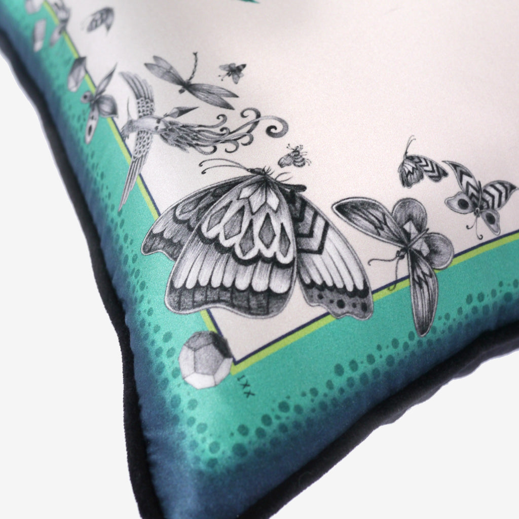 The hand-drawn butterflies that feature on the cotton and silk blend Giraffe Cushion by Emma J Shipley