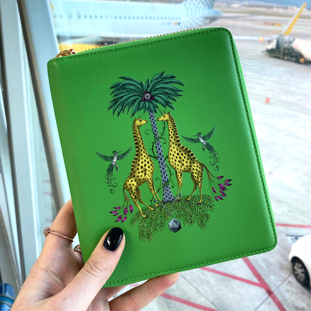 Lifestyle image of the STOW X Emma J Shipley Kruger Mini Leather Tech Case in use while traveling the world. Featuring our magical hand-drawn Kruger design is the luxury travel accessory used by the likes of Meghan Markle