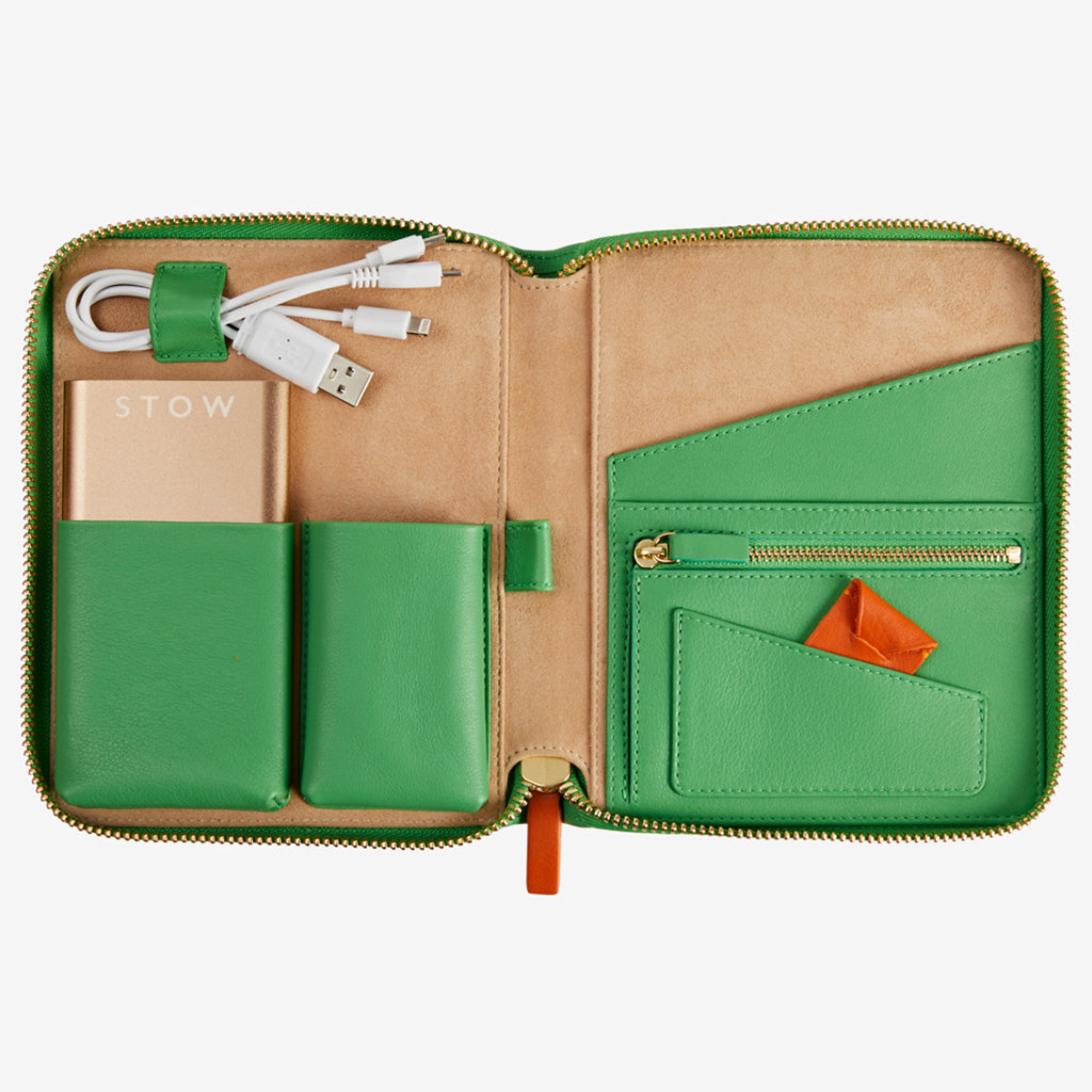 The Kruger Mini Tech Case designed by Emma J Shipley in collaboration with STOW, is made from the highest quality leather and suede, hand made by master craftsman in Spain, stylishly storing all of your travel documents