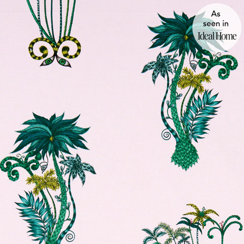 The exotic Jungle Palms cotton satin fabric designed by Emma J Shipley x Clarke & Clarke in pink as seen in Ideal Home