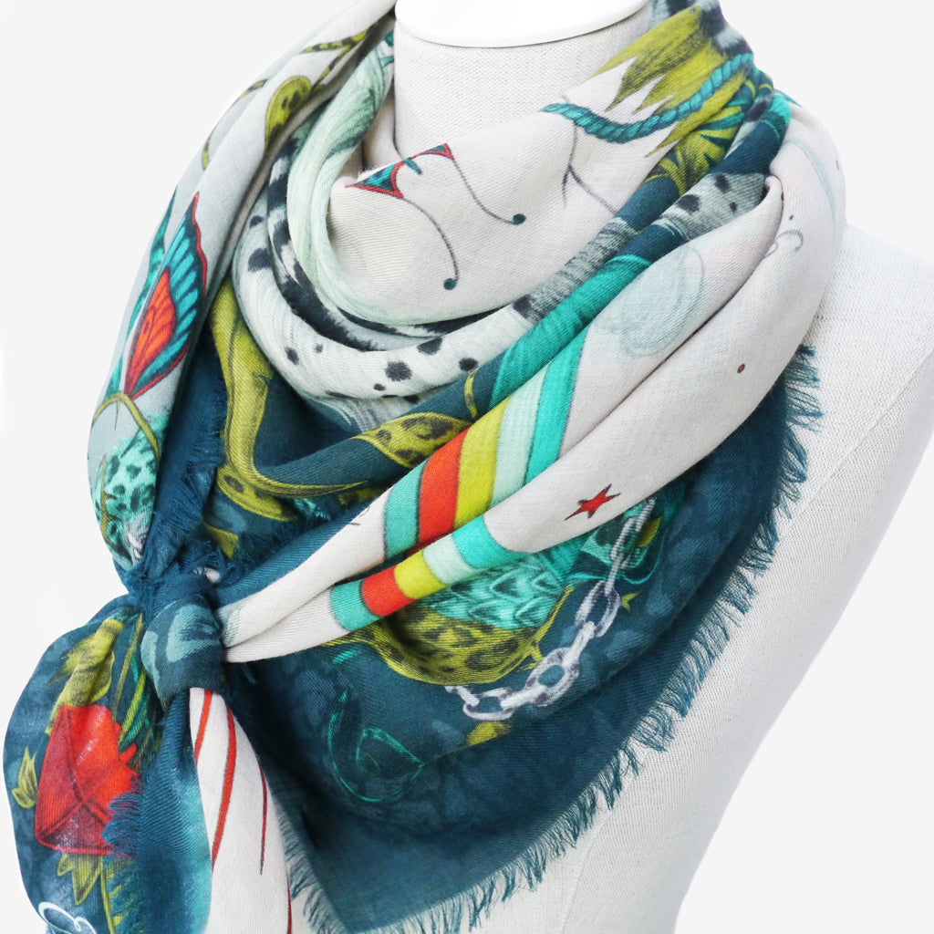Enjoy the close up hand drawn details and the bright flashes of red against the fresh limes and teals of the Lime Lost World design from Emma J Shipley's explorer collection, when worn in this style.