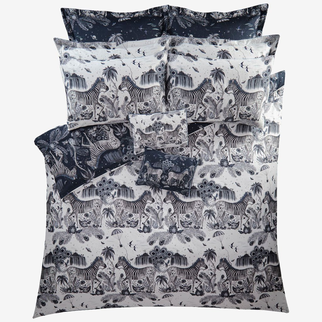 The reverse side of the Navy and Blue Lost World duvet set, beautifully illustrated by Emma J Shipley, made in collaboration with Clarke and Clarke, this shows the monochrome Blue side that can also be used as the main side with a different effect