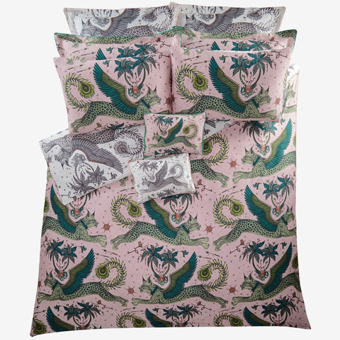 Transform your bedroom into a Magical Lynx inspired dream with the Lynx Duvet Cover in Pink and Nude, designed by Emma J Shipley. Featuring a striking scene of creatures including a flying Winged Lynx with peacock tails.