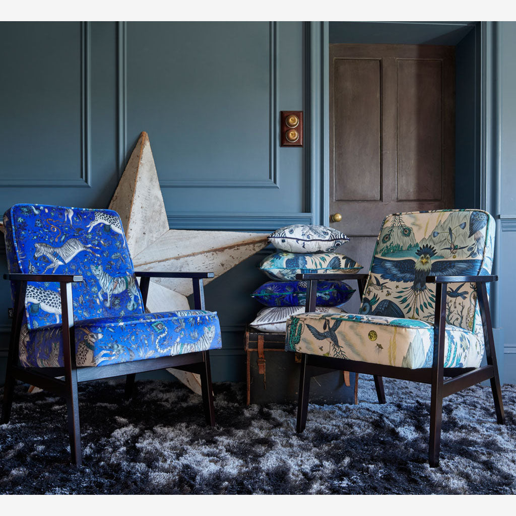 An Armchair upholstered in frontier blue linen, one of the many ways to use the Wilderie collection of fabrics as well as drapery, upholstery and any home wear projects.