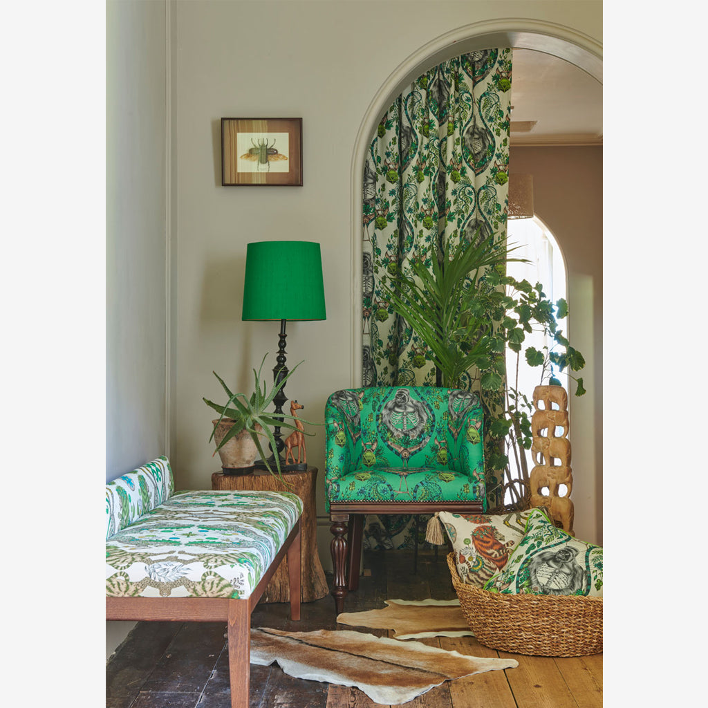 The Caspian Cotton Satin fabric covers a bench in this lifestyle image of Emma J Shipley's Wilderie Collection made in collaboration with Clarke and Clarke