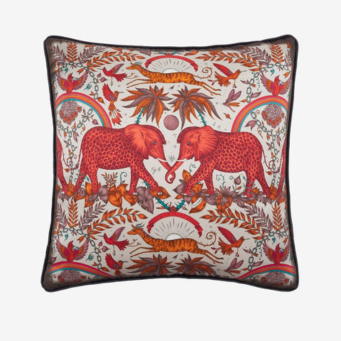 The Zambezi Cushion in red from the Signature Cushion Collection. Featuring majestic spotted elephants, soaring hornbills and leaping gazelles. Designed by Emma J Shipley