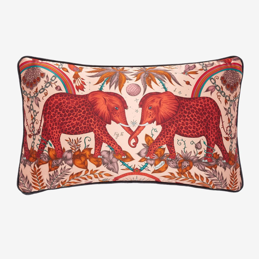 Bring a surreal African safari into your home with the Zambezi Double Bolster Cushion in orange from Emma J Shipley's Signature cushion collection