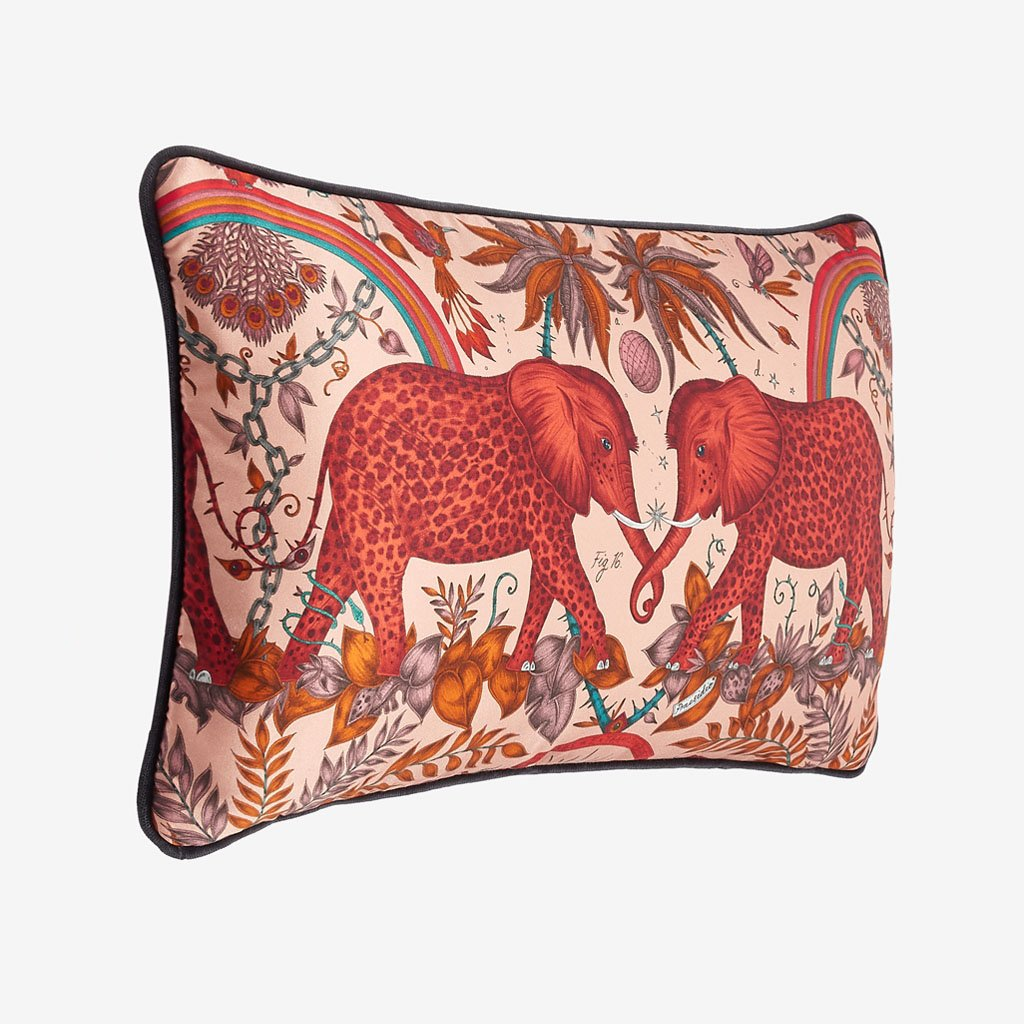 The Zambezi cushion features a striking scene of creatures such as majestic spotted elephants, soaring hornbills, and leaping gazelles, both real and imaginary hand drawn designs by Emma J Shipley