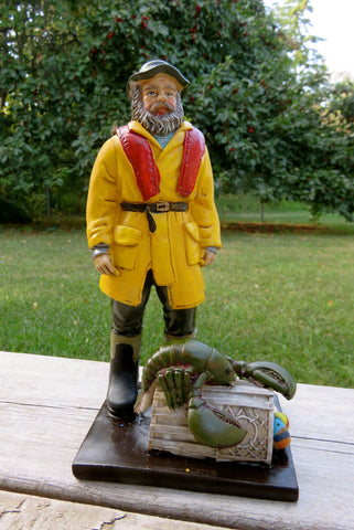 Fisherman Figurine with Lobster Trap 8 in . T. Resin