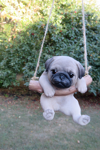 Pug Dog Puppy Hanging On A Swing Johnnyappleseedhomeandyard