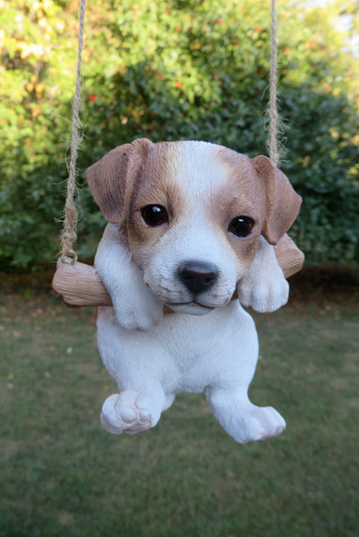 Jack Russell Puppy Hanging On A Swing