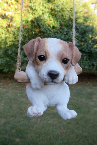 Jack Russell Puppy Hanging on a Swing.