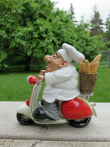 Comical Bakery Chef Riding a Scooter Figurine With Bread Baguettes Warren Stratford