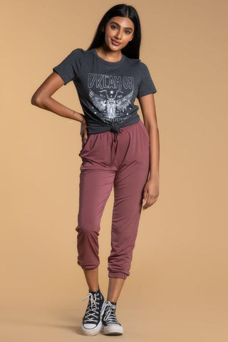 Women wearing graphic tee with mauve joggers