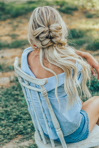 Blonde woman with messy braid