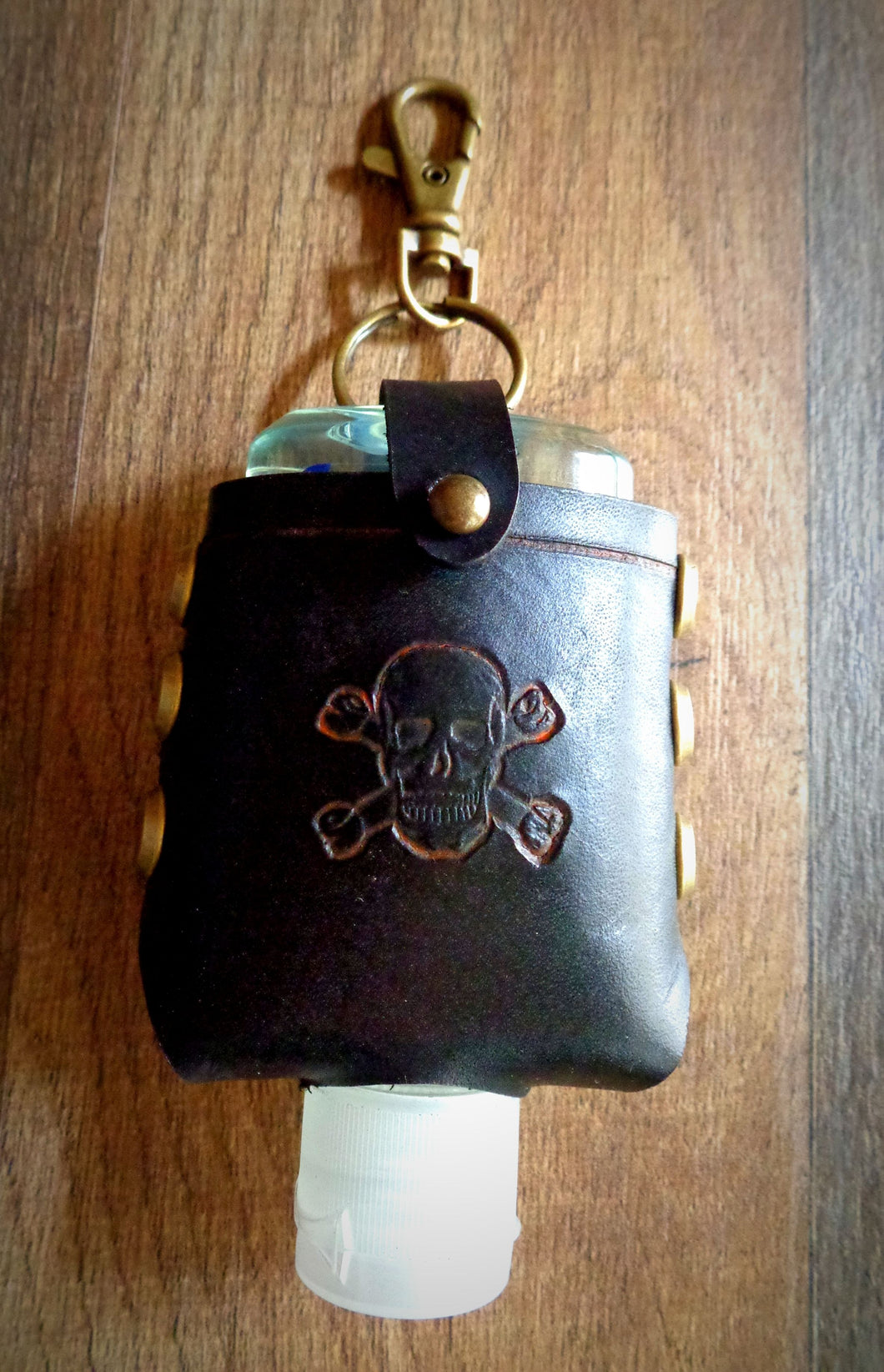 Orange Skull and Crossbones Leather Hand Sanitizer Case