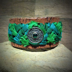 Distressed Green Sari Ribbon Braided Leather Cuff with a Silver and Green Rhinestone Concho