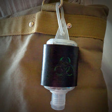 Load image into Gallery viewer, Green Biohazard Leather Hand Sanitizer Holder