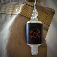 Load image into Gallery viewer, Orange Skull and Crossbones Leather Hand Sanitizer Holder