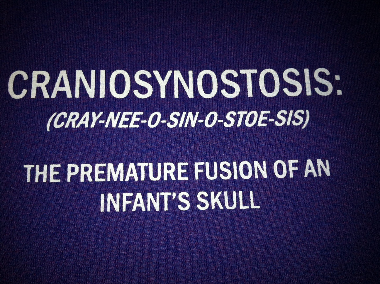 CRANIOSYNOSTOSIS: definition purple shirt with white lettering