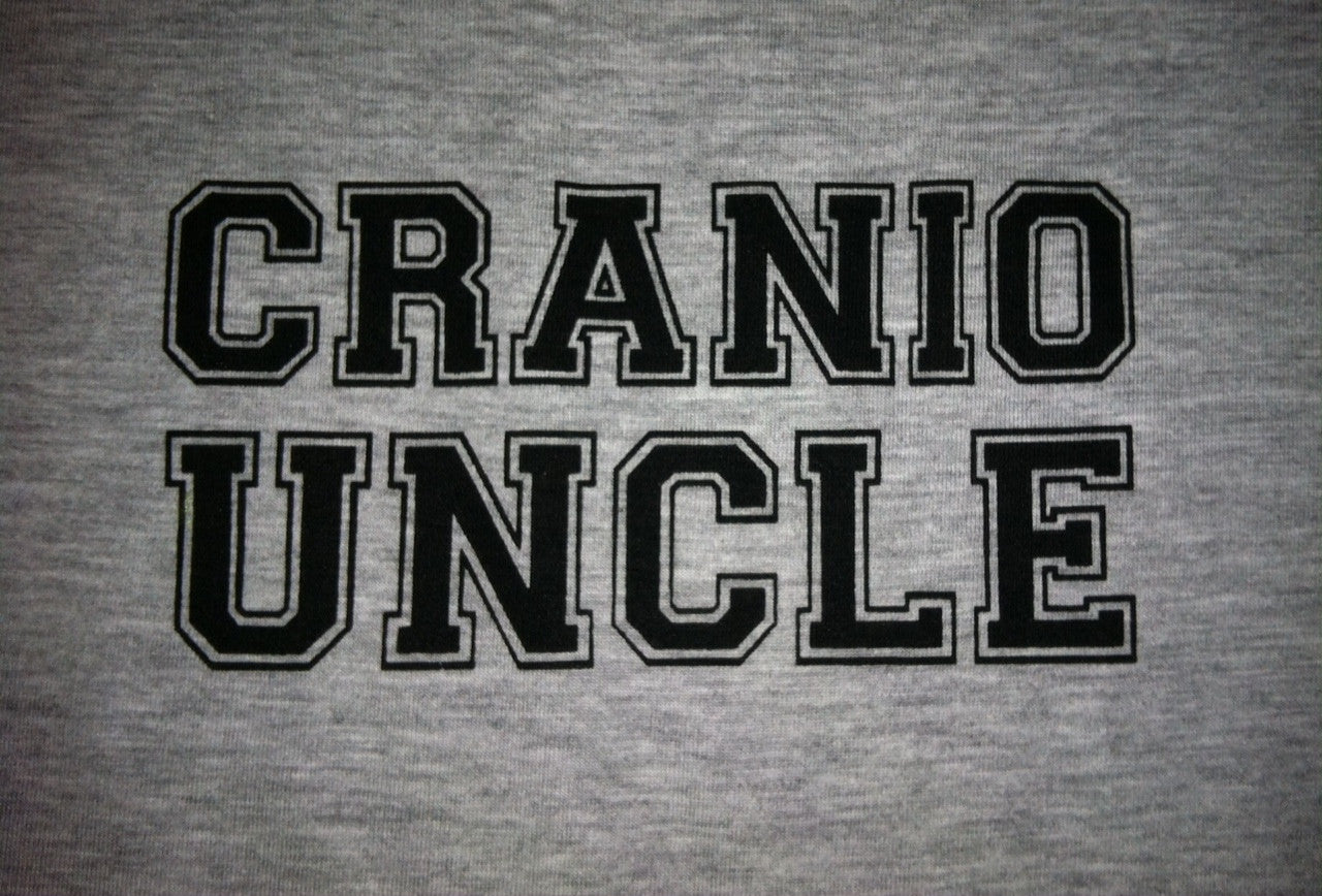 Grey Cranio Uncle shirt with Craniosynostosis definition on the back