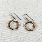 Hoop earrings in copper, brass, and sterling silver from Junk to Jems handmade in Bend, Oregon