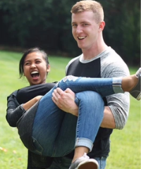 Guy and girl laughing wearing Nayked Apparel