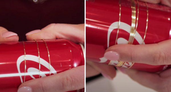 showing wire wrapped around a can to create a bangle bracelet