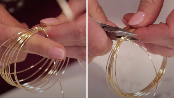 close up of wrapping wire around wire bangle to secure it and pliers flattening wire to secure it