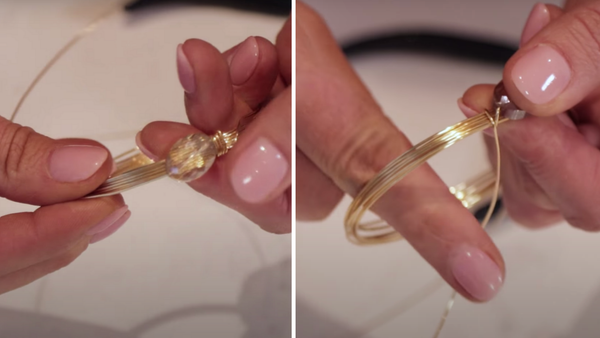 close up of stringing a bead onto a wire bangle