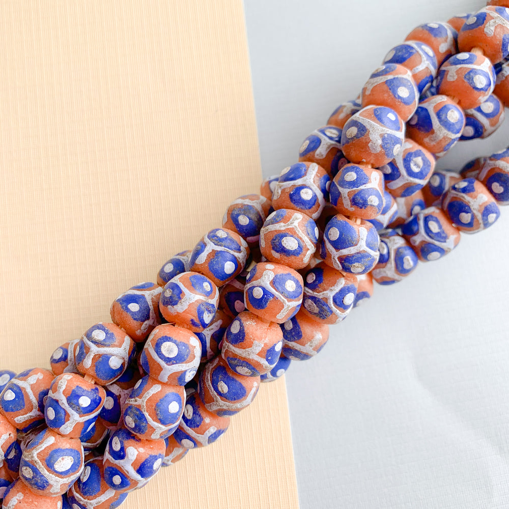 Load image into Gallery viewer, 12mm Blue Spotted Orange Krobo Ghana Glass Strand