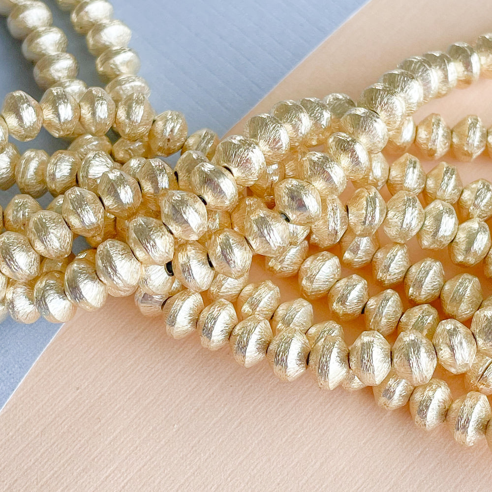 6mm Brushed Gold Bicone Strand