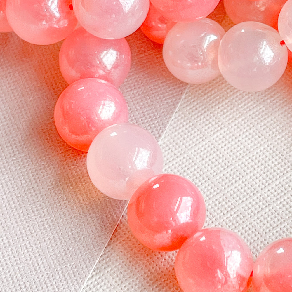 8mm Pearlized Strawberry Chalcedony Rounds Strand