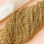 6mm Gold Hematite Rounds Strand