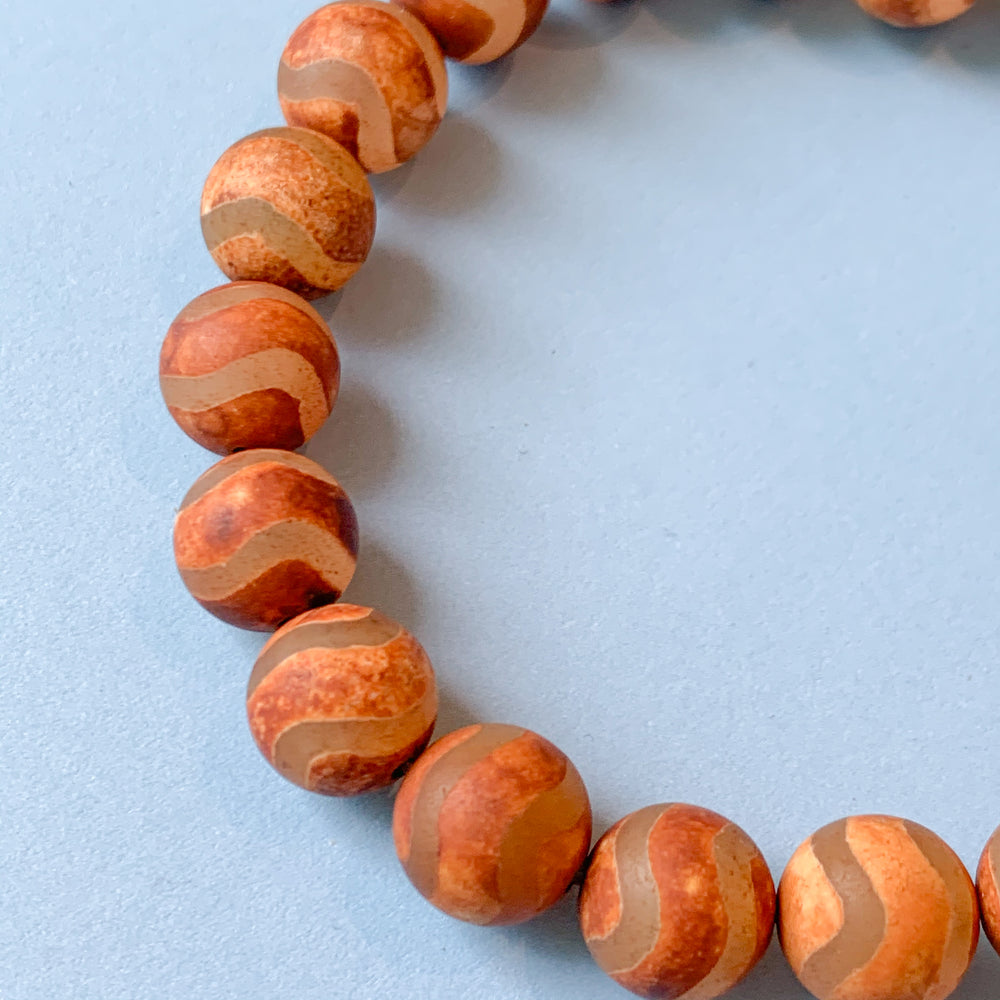 Load image into Gallery viewer, 10mm Smooth Matte Rust DZI Agate Rounds Strand