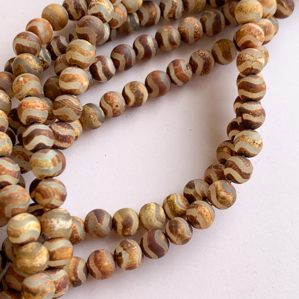 Load image into Gallery viewer, 6mm Smooth Matte Rust DZI Agate Rounds Strand