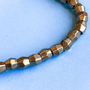 Load image into Gallery viewer, 5mm Brass Faceted Bicone Strand