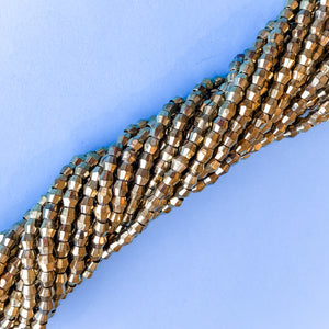 5mm Gold Faceted Bicone Strand