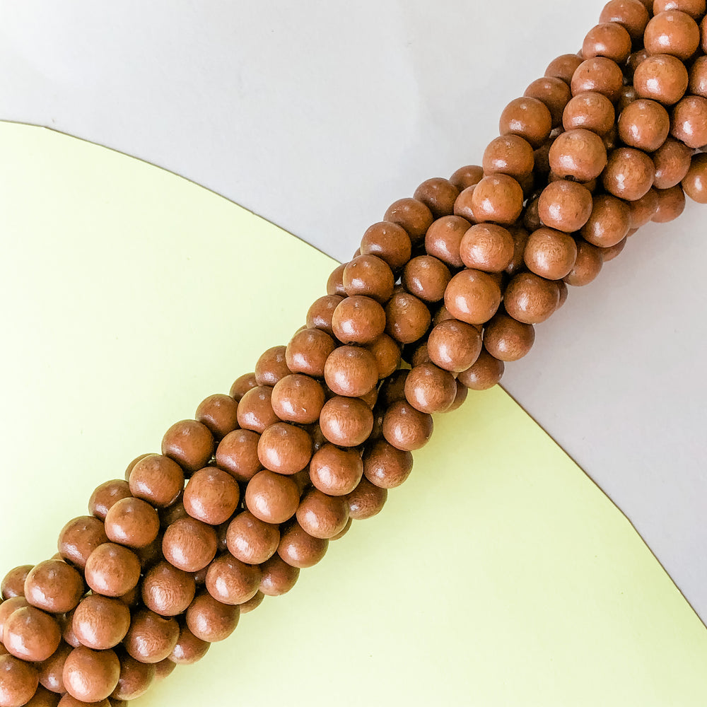 8mm Brown Wood Rounds Strand - Christine White Style