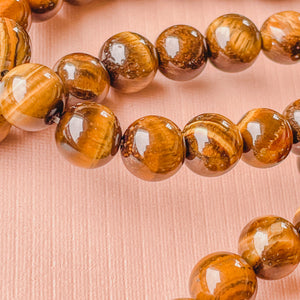 8mm Smooth Tigers Eye Rounds Strand - Christine White Style