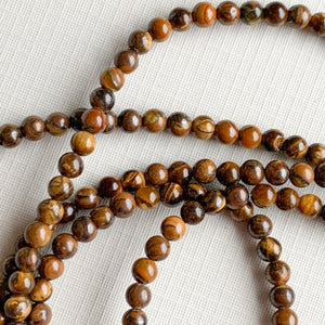 4mm Smooth Natural Tigers Eye Rounds Strand