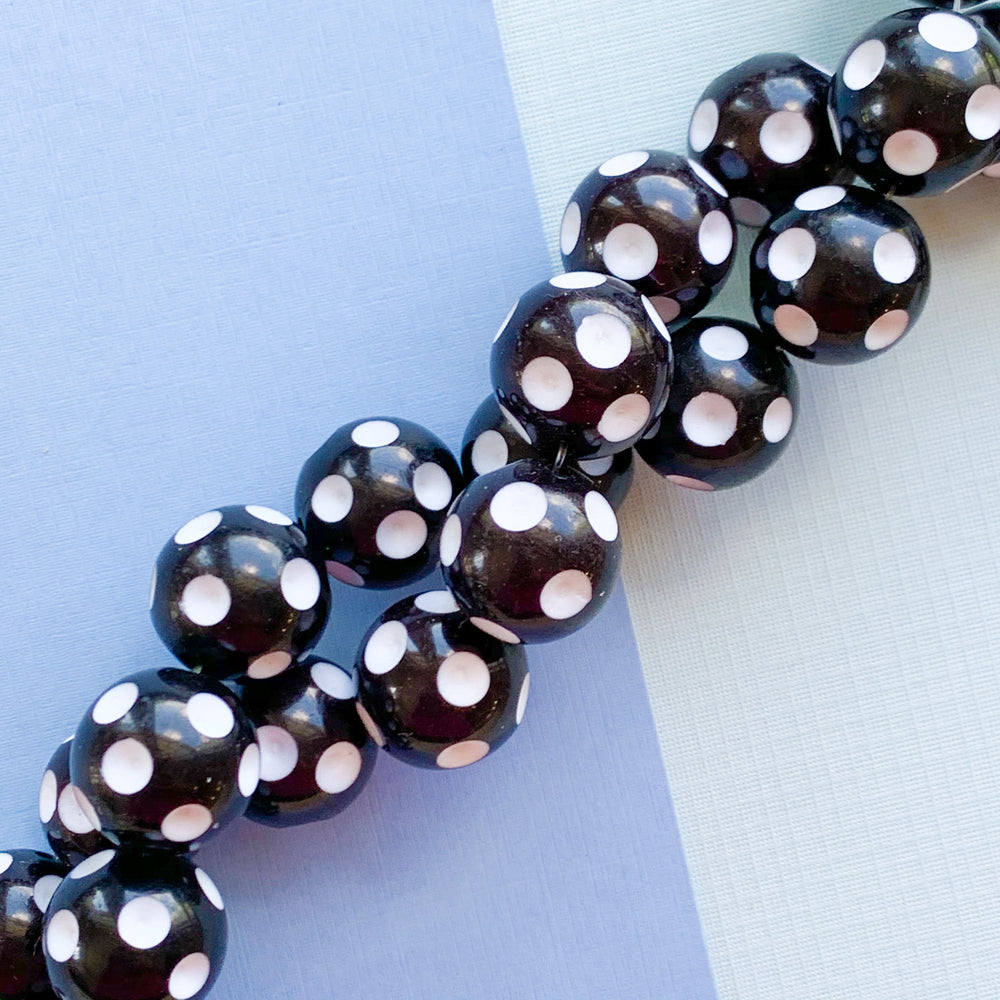 Load image into Gallery viewer, 17mm Black + White Polka Dot Plastic Rounds Strand