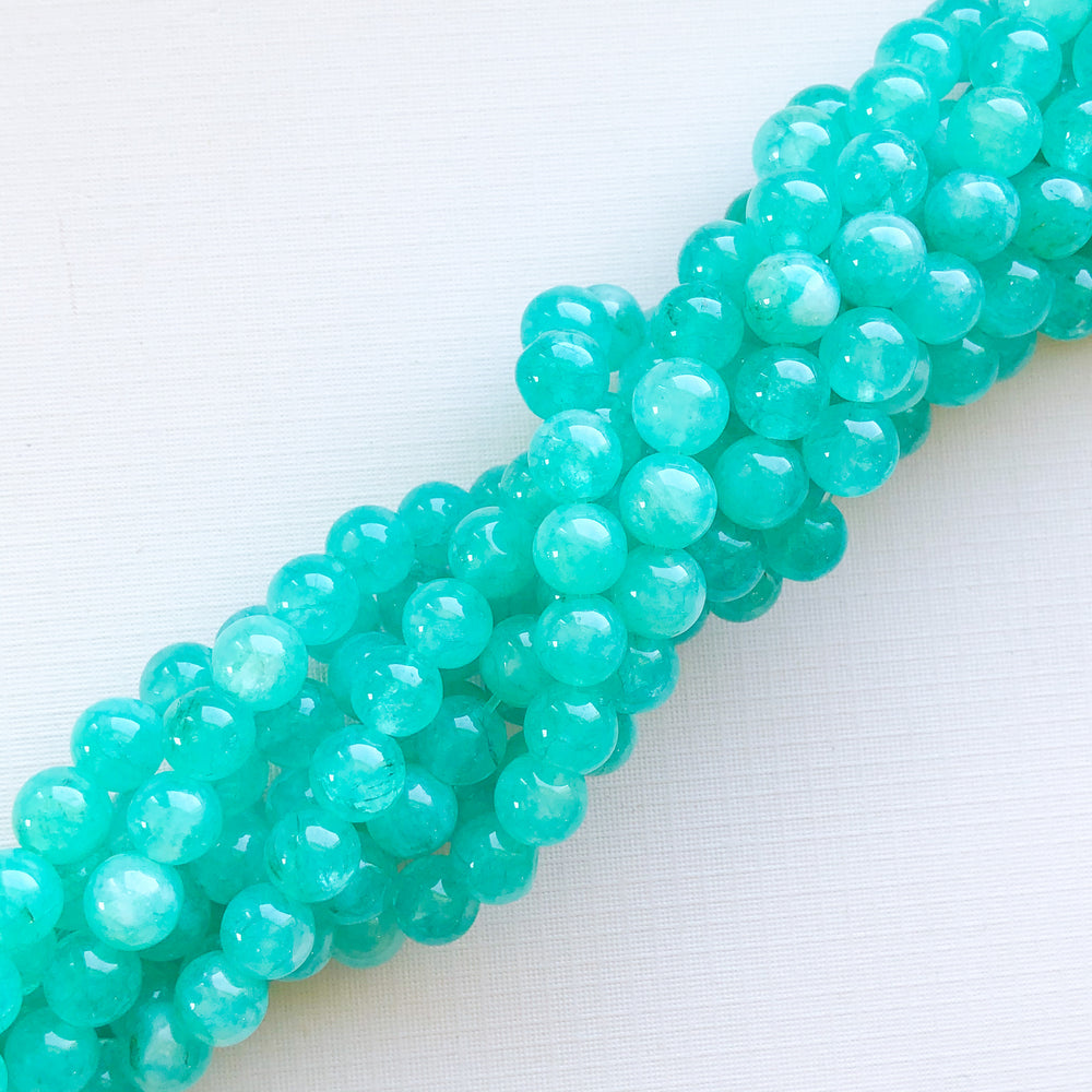 8mm Translucent Teal Dyed Jade Rounds Strand