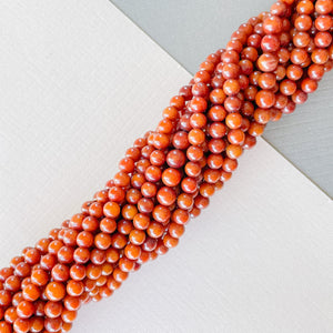 4mm Smooth Bamboo Coral Rounds Strand