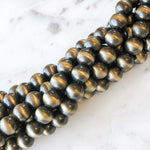 8mm Metallic Gold Navajo Rounds Strand