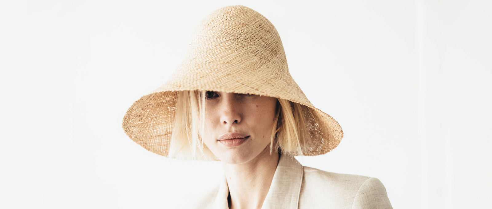 Janessa Leone Summer Women's Hats Summer Spring Hats made for the beach and traveling | wide brimmed straw hats ivory natural cream straw natural straw hat bucket natural straw black and white bucket hat bucket hat for women | bucket hats with long brim | short brimmed bucket style womens hat | Sun protective hat with thick straw weave | Beach travel hat women's bucket hat  unique luxury chic hat