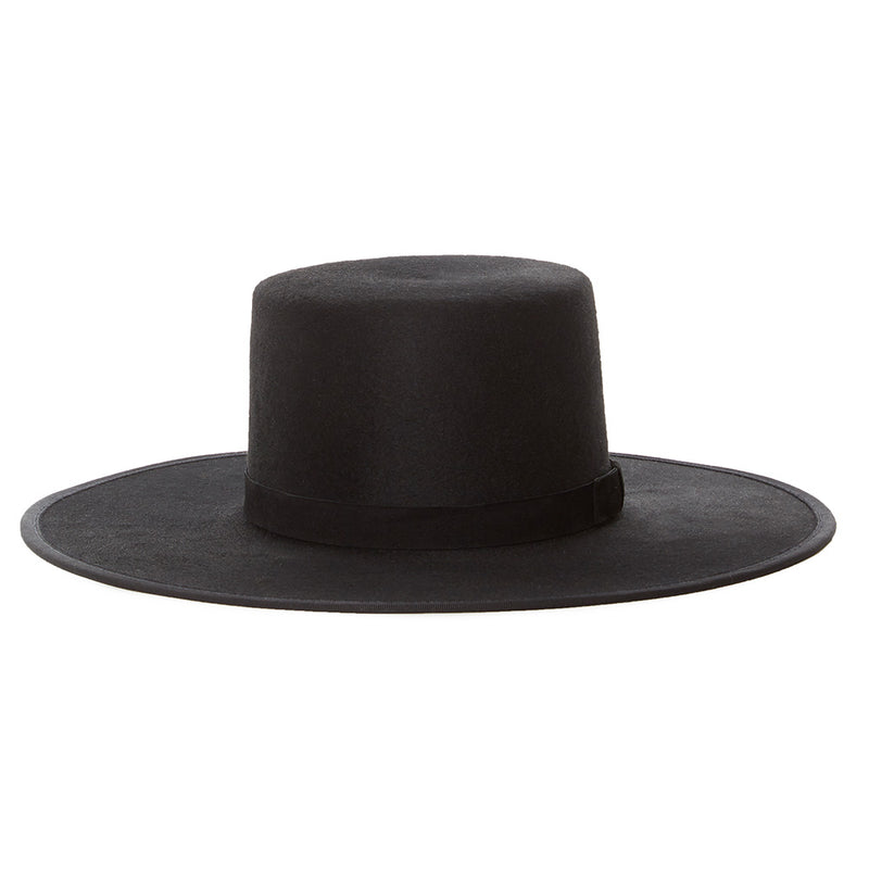 Janessa Leone wide brimmed black bolero with black suede tie. A perfect staple to a winter wardrobe. All black wool felt boater style hat made in the USA. Luxury high end hat made from 100% wool